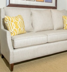 white couch with yellow pillows